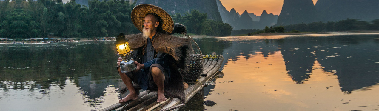 Chinese man on wooden boat